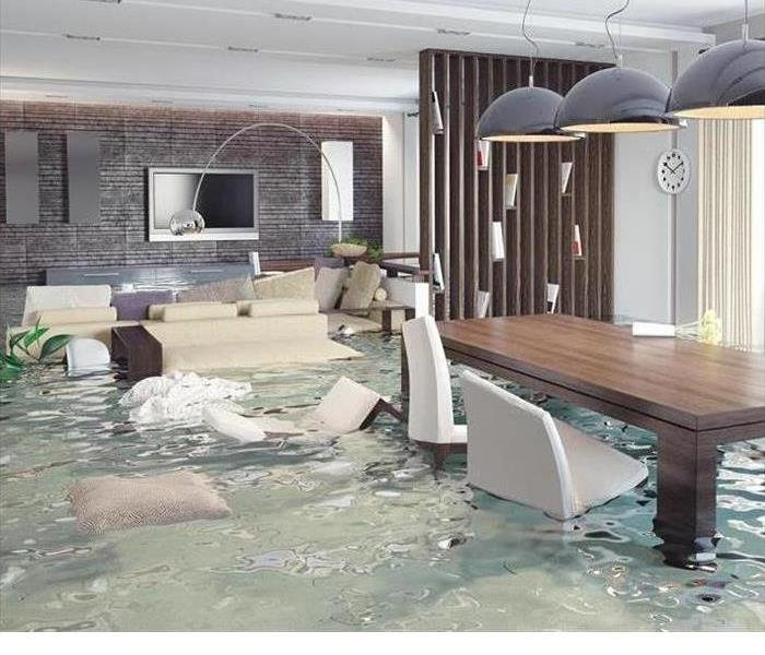 A flooded room is shown in a Florida home